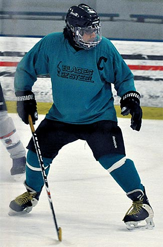 Sal playing hockey